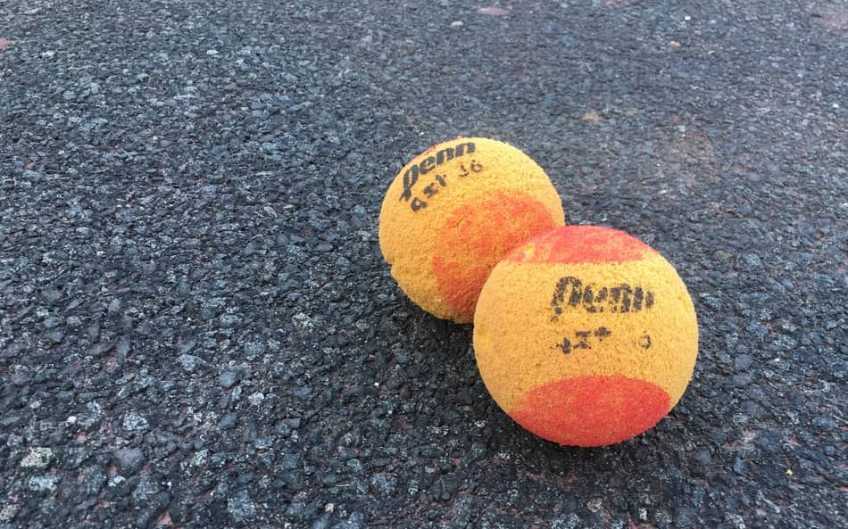 two tennis foam balls