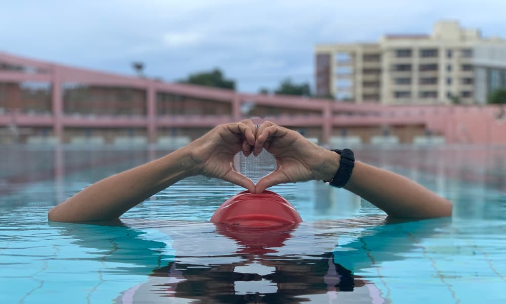 Swimming pool in the summer with the heart