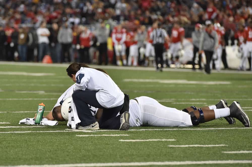 Trainers tends to an injured Nittany Lion player during the NCAA football game