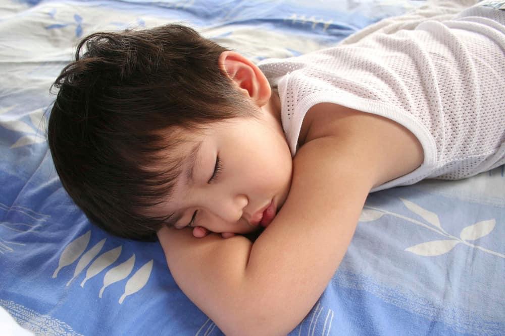 child sleeping swimming