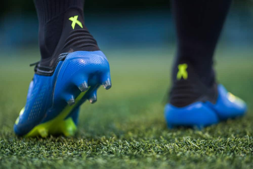 A Football player in training with Adidas X 18