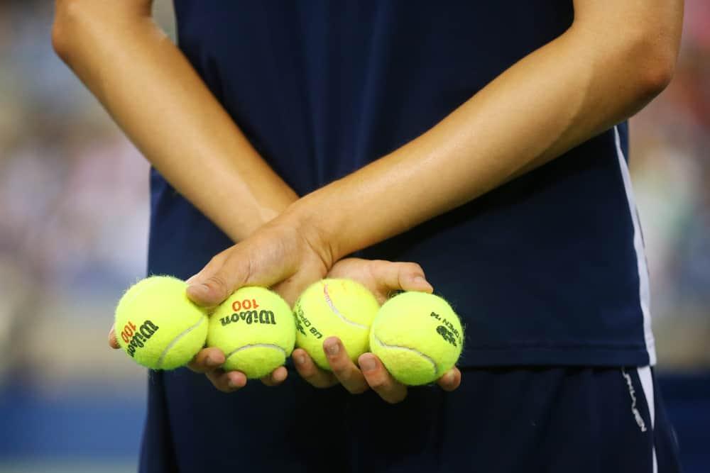 Ball boy holding tennis balls at the Billie Jean King National Tennis Center