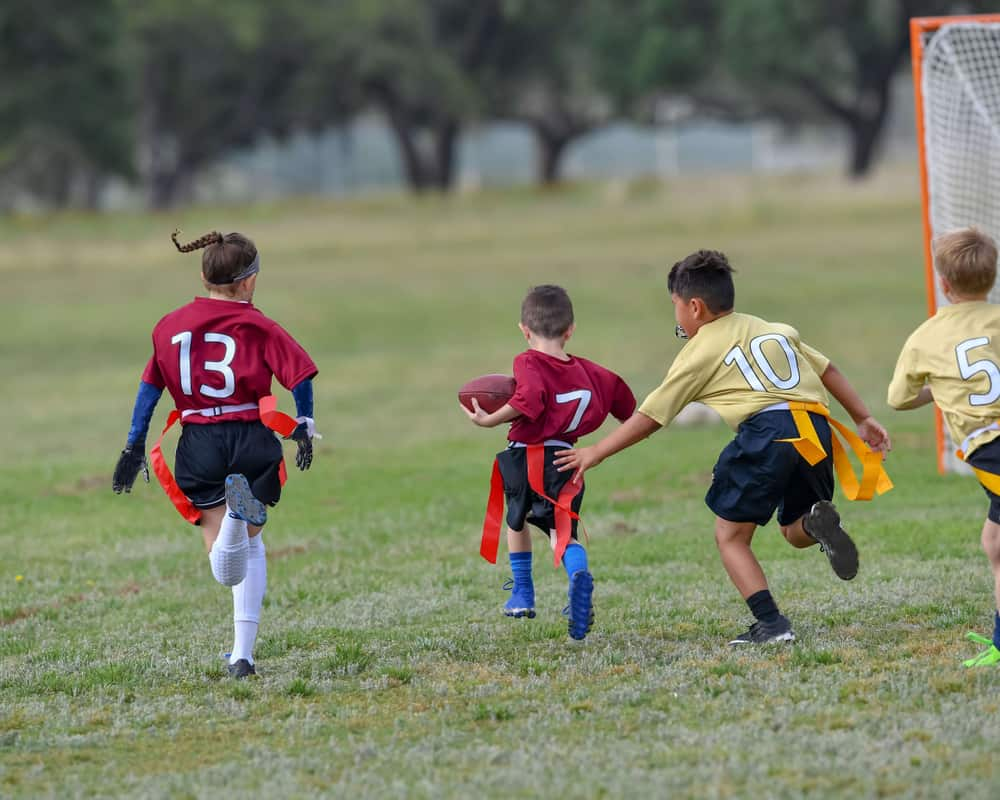 Children playing a Flag Football game outside 1