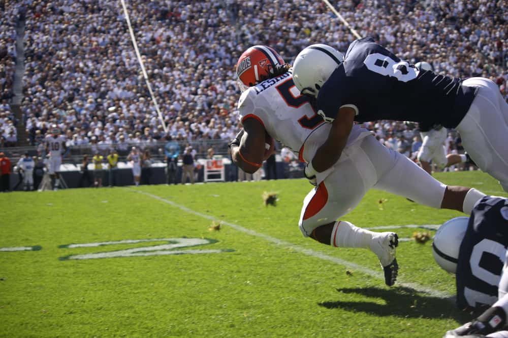 Illinois running back No. 5 Mikel Leshoure is tackled after a long gain during a football game