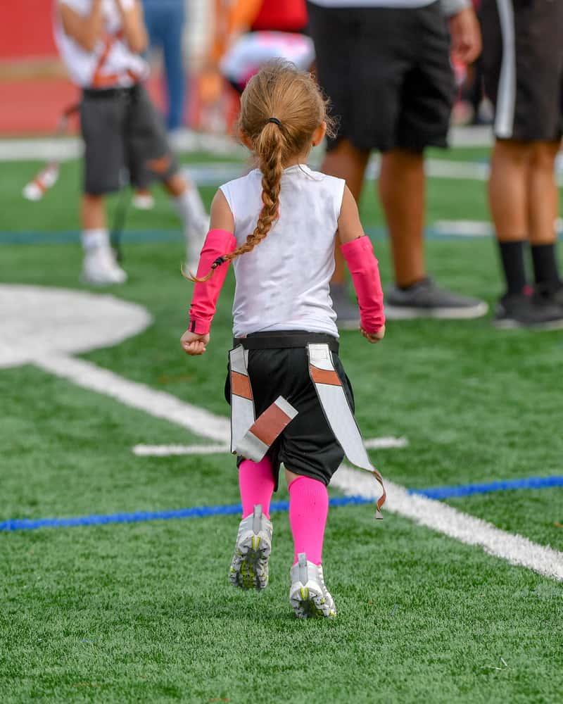 Little girl playing flag football
