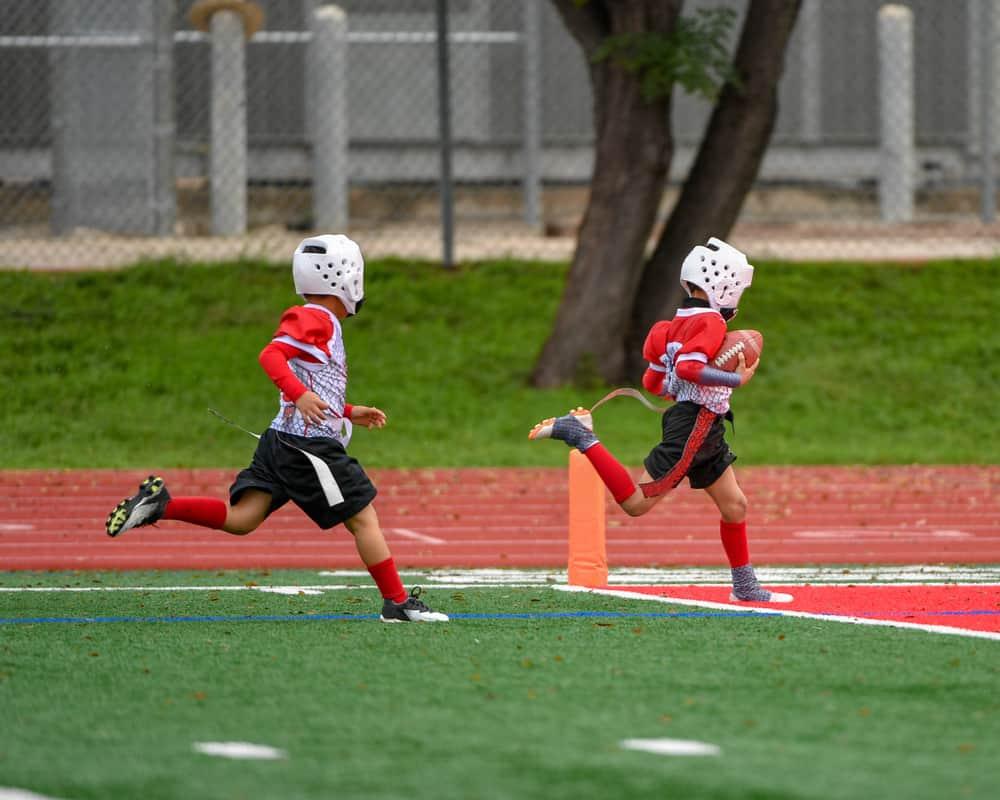 Little kids playing flag football - Image