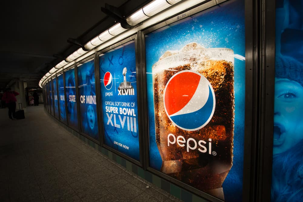 Pepsi Cola Super Bowl advertisements in Times Square NYC subway station football