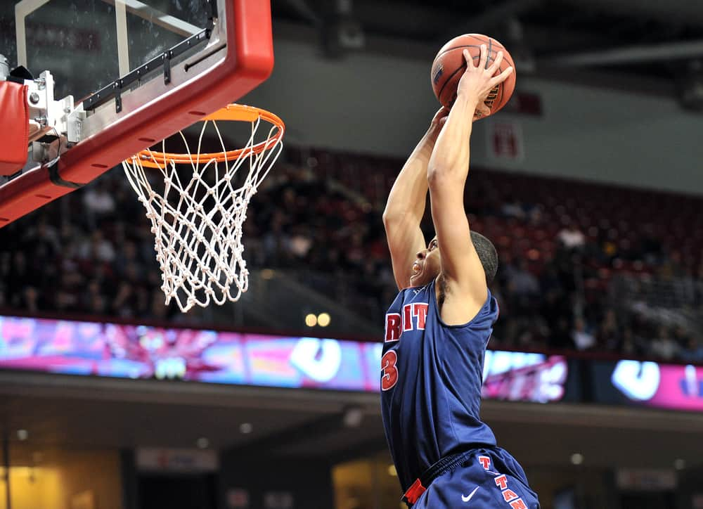 Ray McCallum flies in to slam the ball for a dunk during the basketball game