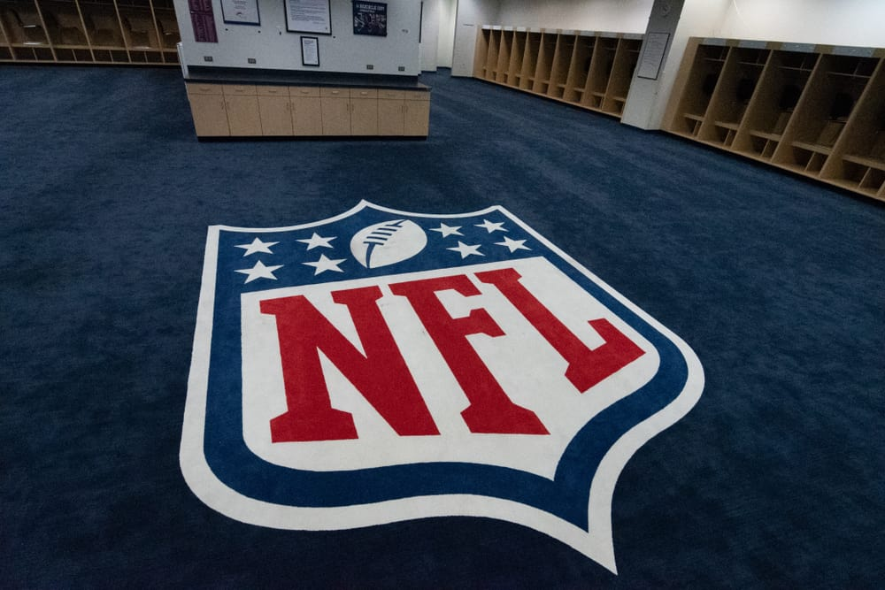 The NFL logo is displayed in the visitors locker room at Mile high Stadium