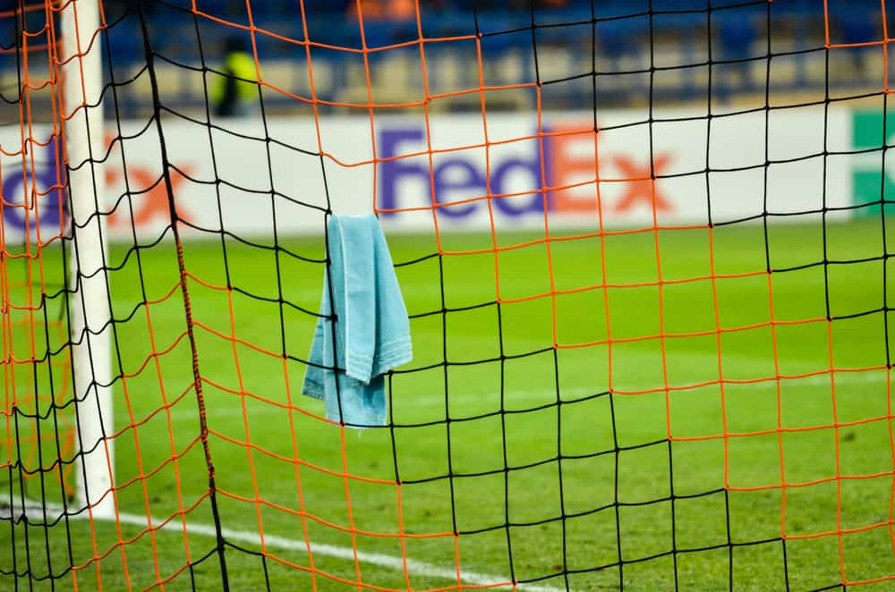 The goalkeeper's towel hangs on the goal net player during the UEFA Europa