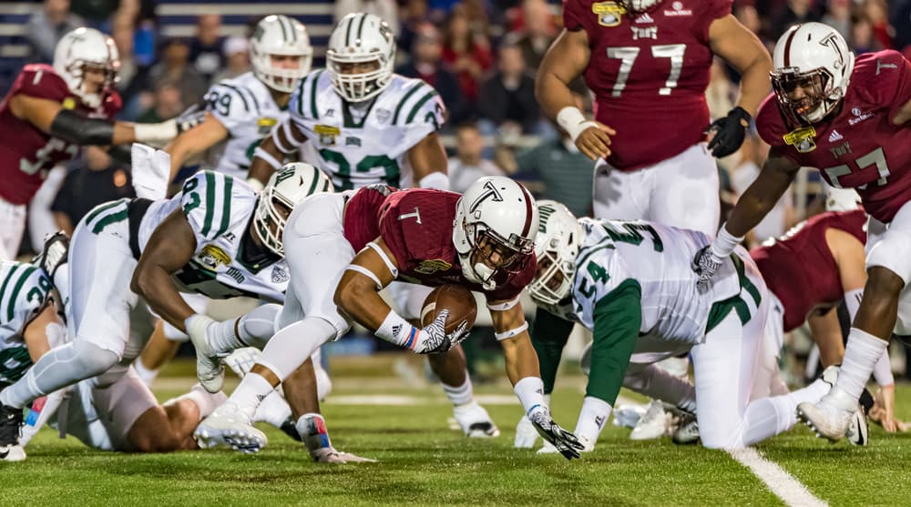 Troy University #26 B.J. Smith recovers his own fumble after a kick-off from the Ohio Bobcats