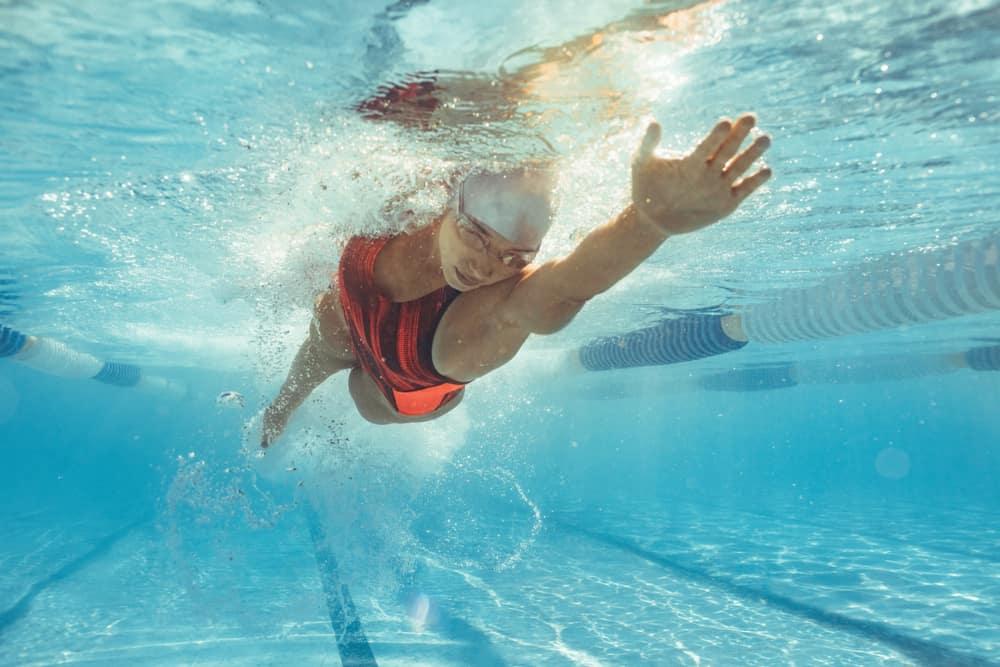 Underwater shot of female athlete swimming in pool