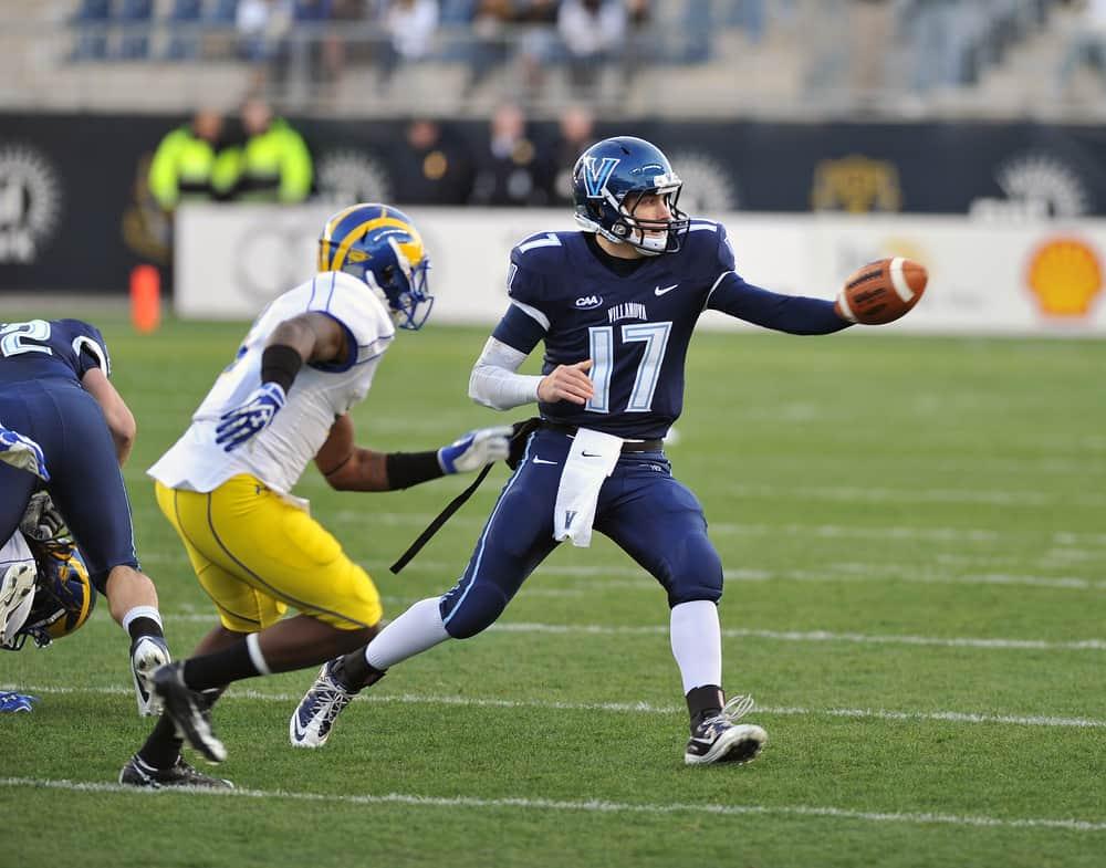 Villanova quarterback pitches the ball during the Delaware-Villanova NCAA football game