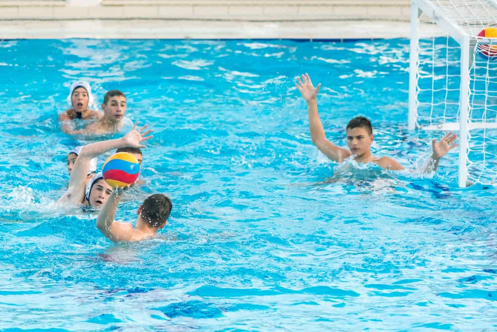 boys playing water polo during competitions