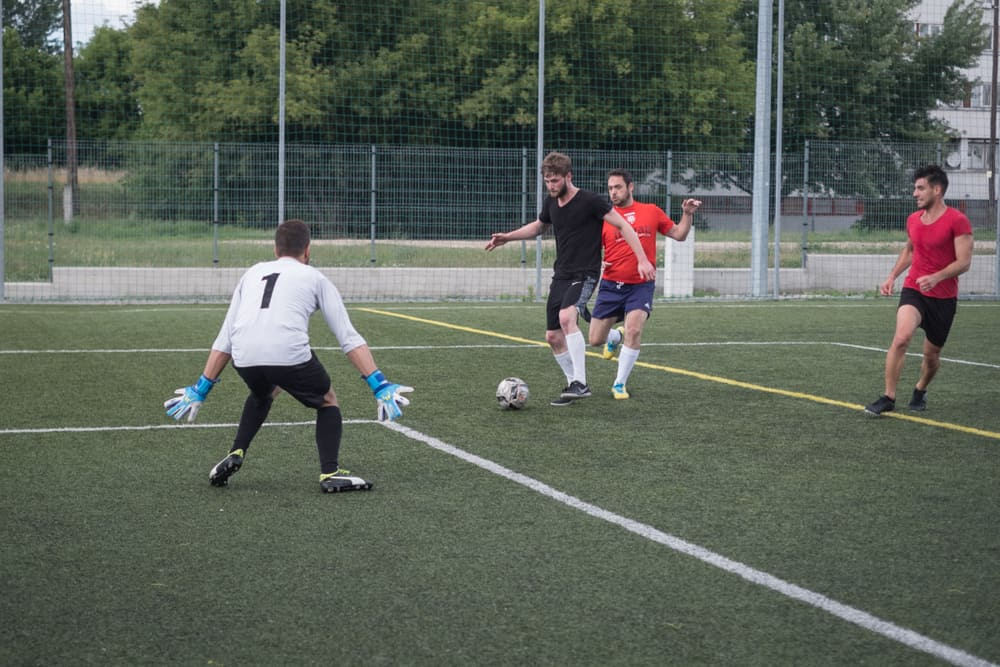 goal keeper trying to parry the ball in a soccer tryouts
