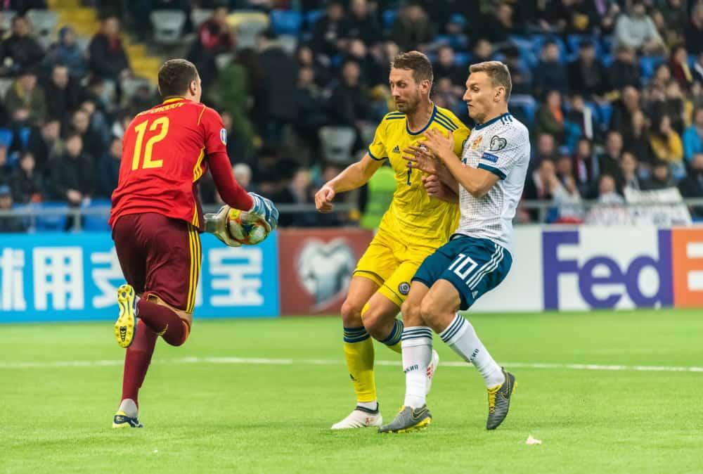 soccer goalkeeper Dmytro Nepohodov, defender Serhiy Malyi and Russia striker Fedor Chalov