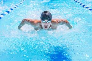 swimmer swimming butterfly stroke in a race