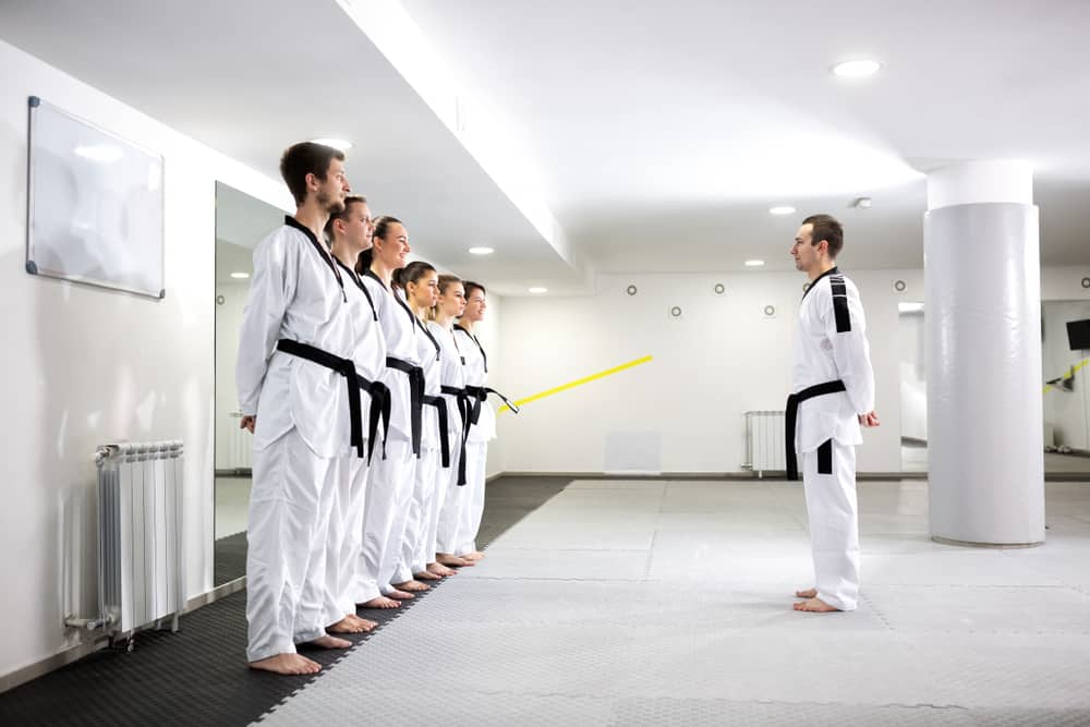 Martial art master lining up his taekwondo students for a new class