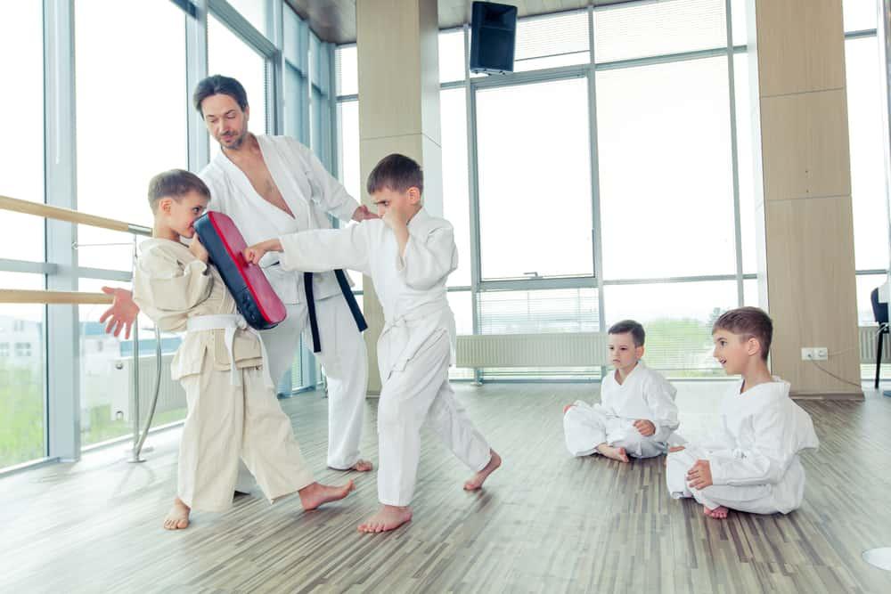 children in taekwondo position