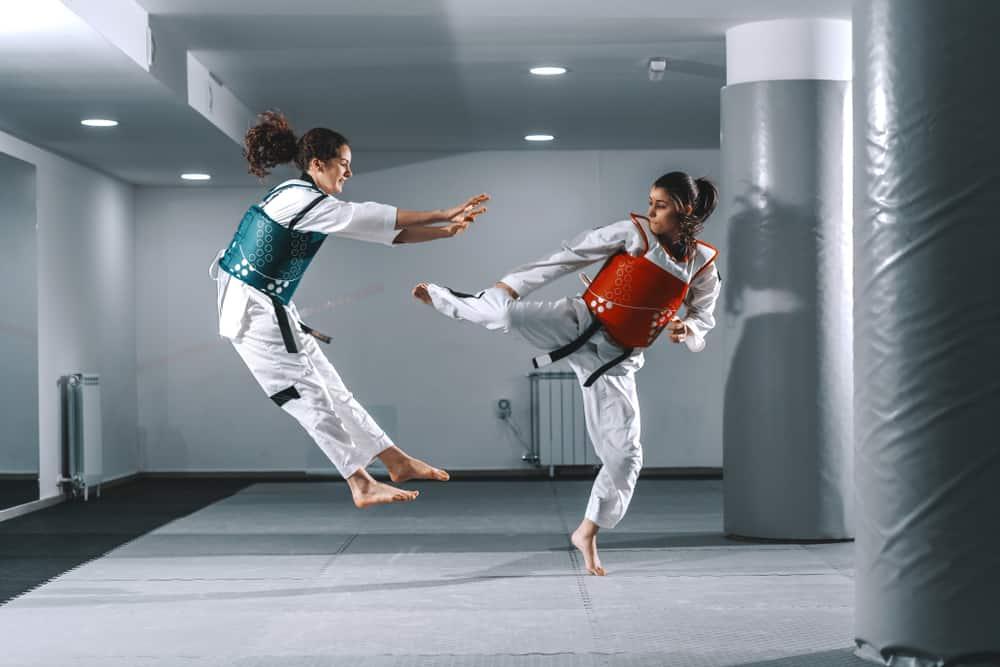 women sparring in taekwondo